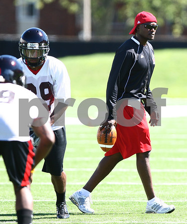 Kyle Bursaw – kbursaw@shawmedia.com<br /> <br /> Cornerbacks coach Richard McNutt patrols the field during practice at Huskie Stadium on Monday, Aug. 6, 2012.