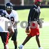 Kyle Bursaw – kbursaw@shawmedia.com<br /> <br /> Cornerbacks coach Richard McNutt patrols the field during practice at Huskie Stadium on Monday, Aug. 6, 2012.
