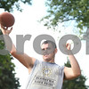 Kyle Bursaw – kbursaw@shawmedia.com<br /> <br /> Hiawatha junior quarterback Mike Mercado warms up his throwing arm for practice on Thursday, Aug. 9, 2012.