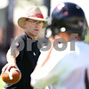 Kyle Bursaw – kbursaw@shawmedia.com<br /> <br /> Defensive Coordinator Jay Niemann works with players during practice at Huskie Stadium on Monday, Aug. 6, 2012.