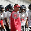 Rob Winner – rwinner@shawmedia.com<br /> <br /> Northern Illinois coach Dave Doeren watches his team during a drill at Huskie Stadium in DeKalb, Ill., on Friday, Aug. 10, 2012.