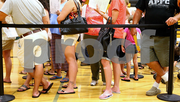 Kyle Bursaw – kbursaw@shawmedia.com<br /> <br /> At Sycamore High School's registration period parents and students wait in line to pay fees in the school's gym on Tuesday, Aug. 7, 2012.