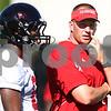 Kyle Bursaw – kbursaw@shawmedia.com<br /> <br /> Northern Illinois head coach Dave Doren talks to Northern Illinois linebacker Ladell Fleming (8)<br /> during practice at Huskie Stadium on Monday, Aug. 6, 2012.