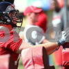 Kyle Bursaw – kbursaw@shawmedia.com<br /> <br /> Northern Illinois offensive lineman Tyler Loos (75) hits a blocking sled during practice at Huskie Stadium on Monday, Aug. 6, 2012