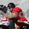 Rob Winner – rwinner@shawmedia.com<br /> <br /> Northern Illinois defensive tackle Anthony Wells (left) is blocked by offensive lineman Matt Killian during practice at Huskie Stadium in DeKalb, Ill., on Friday, Aug. 10, 2012.