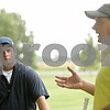 Rob Winner – rwinner@shawmedia.com<br /> <br /> Hinckley-Big Rock's Luke Winkle (left) listens to his coach Randy Jandt at the start of practice at Indian Oaks Country Club in Shabbona, Ill., Wednesday, Aug. 8, 2012.