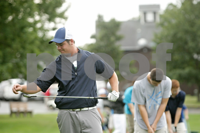 Rob Winner – rwinner@shawmedia.com<br /> <br /> Hinckley-Big Rock's Luke Winkle removes grass from one of his clubs during the first day of practice at Indian Oaks Country Club in Shabbona, Ill., Wednesday, Aug. 8, 2012.