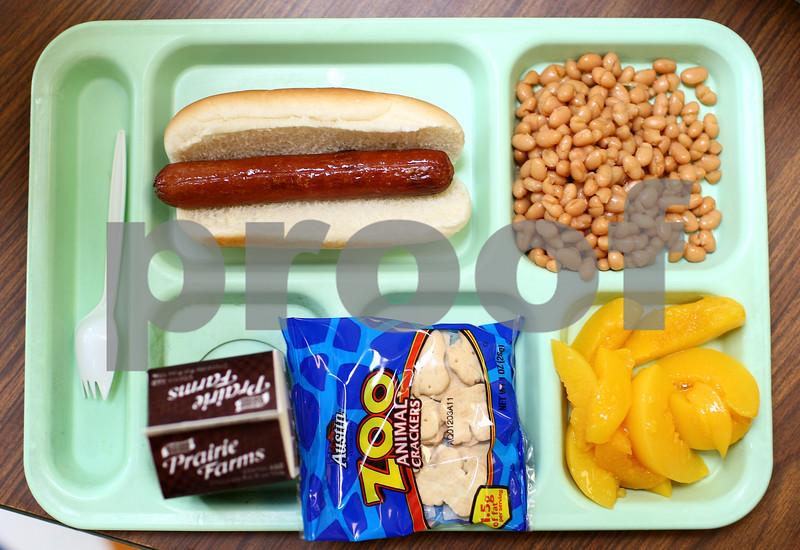 Kyle Bursaw – kbursaw@shawmedia.com<br /> <br /> A hot lunch at Genoa Elementary on Thursday, Aug. 16, 2012.