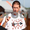 Kyle Bursaw – kbursaw@shawmedia.com<br /> <br /> DeKalb cross country coach Mike Wolf talks to some of his runners at the start of practice outside the high school on Tuesday, Aug. 14, 2012.