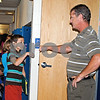 Fifth-grader Max Schaffer pounds fists with his teacher, Tim Anderson, as he enters class at Genoa Elementary School Thursday, which was the first full day of school.<br /> <br /> By Nicole Weskerna - nweskerna@shawmedia.com
