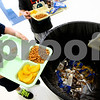 Kyle Bursaw – kbursaw@shawmedia.com<br /> <br /> Students at Genoa Elementary school empty their trays in the trash, included the uneaten portions on Thursday, Aug. 16, 2012.