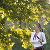 Kyle Bursaw – kbursaw@shawmedia.com<br /> <br /> Genoa-Kingston junior Andrea Strohmaier watches her shot at the Oak Club golf course in Genoa, Ill. on Friday, Aug. 10, 2012.