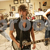 Rob Winner – rwinner@shawmedia.com<br /> <br /> Members of the Rockford-area band Desolation Row including Jarrett Finley (from left to right), 19, Alex Spors, 19, Jared Hoey, 17, and Jacob Hoey, 16, practice at Spors' home in Rockford, Ill., Thursday, Aug. 9, 2012. The band recently won the Sycamore Park District's Battle of the Bands competition and will perform at the Illinois State Fair in Springfield.