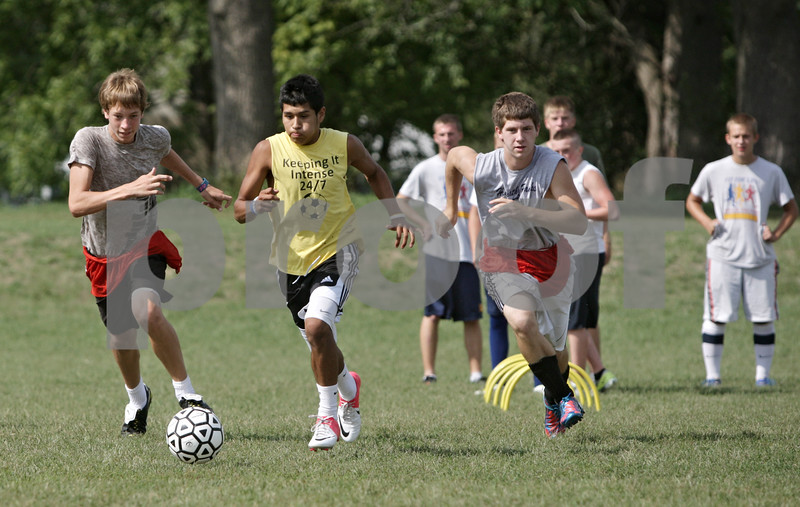Rob Winner – rwinner@shawmedia.com<br /> <br /> Pancho Garcia (center) controls a ball during a drill at practice in Kirkland, Ill., Tuesday, Aug. 14, 2012.