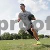 Rob Winner – rwinner@shawmedia.com<br /> <br /> Ed Canchola of Hiawatha carries a medicine ball while running a drill at practice in Kirkland, Ill., Tuesday, Aug. 14, 2012.
