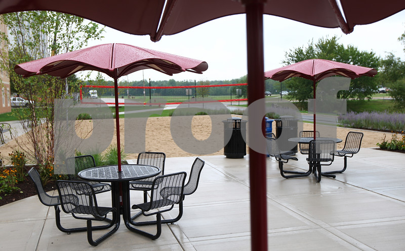 Kyle Bursaw – kbursaw@shawmedia.com<br /> <br /> The new residential hall at Northern Illinois University has a sand volleyball court, a basketball hoop and a patio area.<br /> <br /> Monday, Aug. 13, 2012.