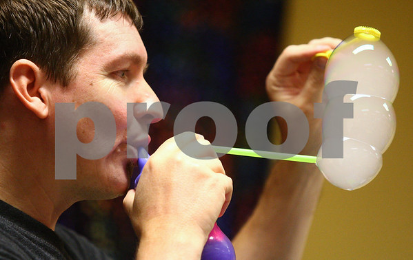 Kyle Bursaw – kbursaw@shawmedia.com<br /> <br /> Geoff Akins of Bubble Wonders creates a chain of white bubbles during a show at the Sycamore Public Library on Thursday, Aug. 16, 2012.