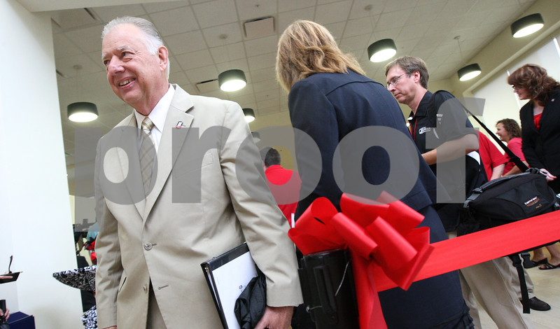 Kyle Bursaw – kbursaw@shawmedia.com<br /> <br /> Northern Illinois University President John Peters moves around talking to guests in the center building of the new residential complex at Northern Illinois University prior to the ribbon cutting ceremony on Monday, Aug. 13, 2012.