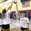 Kyle Bursaw – kbursaw@shawmedia.com<br /> <br /> Indian Creek's Taylor Landsteiner gives the ball a tip to clear the net and blockers during practice at Shabbona Elementary on Monday, Aug. 13, 2012.