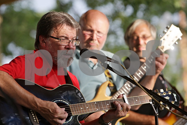 Rob Winner – rwinner@shawmedia.com<br /> <br /> Kirkland mayor Les Bellah (front) sings and plays the guitar with his band, The Patchwork Volunteer Band, during the 4th annual Pickin' in the Park at Franklin Township Park to help raise for the Joe McGuan Scholarship fund, which provides assistance for the education of children and grandchildren of veterans.<br /> <br /> ***The other members behind Bellah are Dave Guzzardo (middle) and Jeff Dover. They aren't in focus so I left their names out, but if you think they should be added then please do so. Kirkland, Ill.<br /> Wednesday, Aug. 15, 2012***
