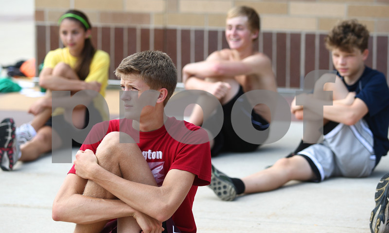 Kyle Bursaw – kbursaw@shawmedia.com<br /> <br /> Sycamore cross country runner David Emmert (front) stretches out with the team at the end of practice on Friday, Aug. 10, 2012.
