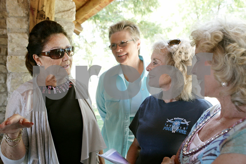 Rob Winner – rwinner@shawmedia.com<br /> <br /> (From left to right) Maxine Maness, Marilyn Hubbard, Sara McCormick and Mary McCormick, all members of the original Marlyn Majorettes, reminisce during their annual picnic at Sycamore Community Park Saturday afternoon.