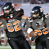 Kyle Bursaw – kbursaw@shawmedia.com<br /> <br /> DeKalb's Dre Brown (33) looks for a lane as Wes Leffelmann (62) blocks in the first quarter of the game against Galesburg at DeKalb High School on Friday, Aug. 24, 2012.