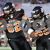Kyle Bursaw – kbursaw@shawmedia.com<br /> <br /> DeKalb's Dre Brown (33) looks for a lane as Wes Leffelmann (62) blocks in the first quarter of the game against Galesburg at DeKalb High School on Friday, Aug. 24, 2012.