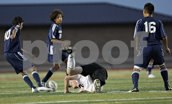 Rob Winner – rwinner@shawmedia.com<br /> <br /> DeKalb's Cully Hicks (22) is tripped up during the second half at Barb Cup in DeKalb Thursday, Aug. 23, 2012. DeKalb defeated Belvidere North, 3-0.