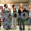 Kyle Bursaw – kbursaw@shawmedia.com<br /> <br /> New teachers to District 428, including Karissa Foelske, a special education teacher at Huntley Middle School (third from right, holding mic), go down the line and introduce themselves at a luncheon at DeKalb High School on Wednesday, Aug. 22, 2012.