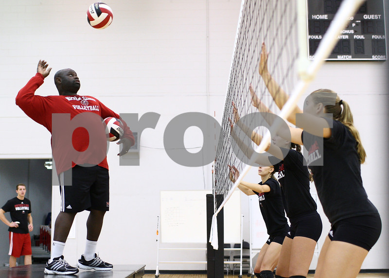 Kyle Bursaw – kbursaw@shawmedia.com<br /> <br /> Northern Illinois University volleyball coach Ray Gooden sends the ball over the net while running a drill at practice on Monday, Aug. 20, 2012.