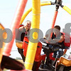 Kyle Bursaw – kbursaw@shawmedia.com<br /> <br /> DeKalb residents (from left) Shanna MacNeille, 12, and Dominick Allen, 10, ride the tornado at Cornfest on Friday, Aug. 24, 2012.
