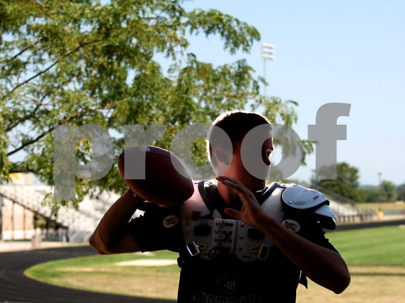 Kyle Bursaw – kbursaw@shawmedia.com<br /> TAB COVER<br /> Quarterback Devin Mottet at Sycamore High School on Friday, Aug. 3, 2012.