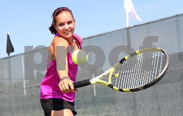 Kyle Bursaw – kbursaw@shawmedia.com<br /> <br /> Kaneland sophomore Sammie Schrepferman returns a ball while doing a drill at practice on Wednesday, Aug. 15, 2012.e