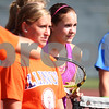 Kyle Bursaw – kbursaw@shawmedia.com<br /> <br /> Kaneland sophomore Sammie Schrepferman (center right) and her teammates listen as coach Tim Larsen gives directions at practice on Wednesday, Aug. 15, 2012.
