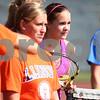 Kyle Bursaw – kbursaw@shawmedia.com<br /> <br /> Kaneland sophomore Sammie Schrepferman (center right) and her teammates listen as coach Tim Larsen gives directions at practice on Wednesday, Aug. 15, 2012.