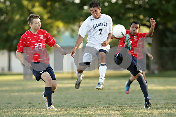 Rob Winner – rwinner@shawmedia.com<br /> <br /> Keith's Dakota Schmidt (from left to right), Hiawatha's Luis Martinez, and Keith's Danny Morales look to control a ball during the second half in Kirkland Tuesday. Keith defeated Hiawatha, 2-1.