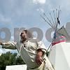 Rob Winner – rwinner@shawmedia.com<br /> <br /> John Tolliver, of DeKalb, tosses an axe at a target during the Boy Scout Troop 33 Living History event at Kiwanis Park in DeKalb Saturday, Aug. 18, 2012.
