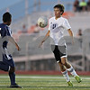 Rob Winner – rwinner@shawmedia.com<br /> <br /> DeKalb's Trevor Freeland tries to control a ball in front of the Belvidere North goal during the second half at Barb Cup in DeKalb Thursday, Aug. 23, 2012. DeKalb defeated Belvidere North, 3-0.