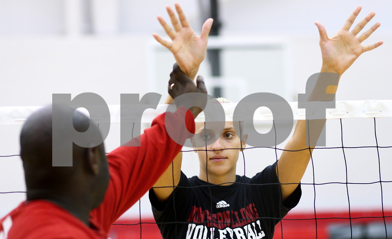 Kyle Bursaw – kbursaw@shawmedia.com<br /> <br /> Northern Illinois University volleyball coach Ray Gooden advises middle blocker Sarah Angelos while running a blocking drill at practice on Monday, Aug. 20, 2012.