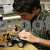 Rob Winner – rwinner@shawmedia.com<br /> <br /> Northern Illinois University junior Ryan Riddel works on his autonomous sonic car before a test run within a lab at the Engineering Building Friday afternoon. Riddel, with the help of local businesses, plans to launch a competitive robotics club at NIU.