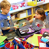 Kyle Bursaw – kbursaw@shawmedia.com<br /> <br /> Dylan Lisner and Juliana Retuerto work on organizing and putting away their school supplies on their first day in Mrs. Tifanny Ryan's second grade class at North Grove Elementary on Wednesday, Aug. 22, 2012.<br /> ****NOTE Tifanny spells her name w/ one F, two N's*****