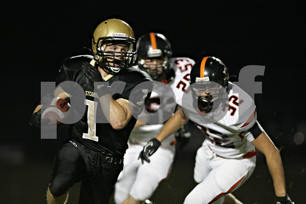 Rob Winner – rwinner@shawmedia.com<br /> <br /> Sycamore running back Austin Culton (1) carries the ball during the Spartans' first possession in the first quarter in Sycamore Friday, Aug. 24, 2012.