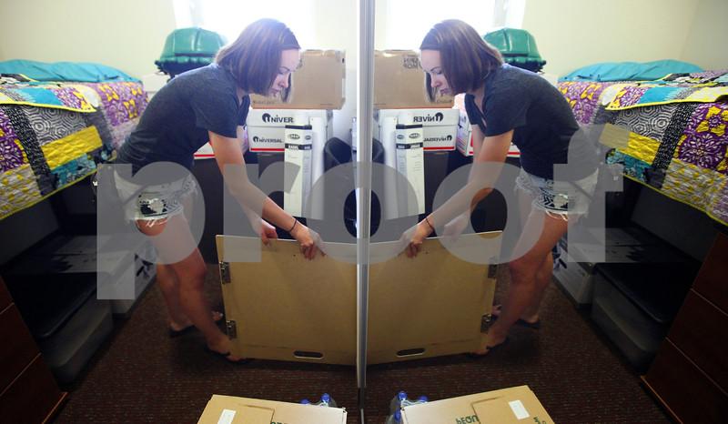Kyle Bursaw – kbursaw@shawmedia.com<br /> <br /> Sophomore art major Amy Henkel unpacks her room in New Residence Hall East on Thursday, Aug. 23, 2012.