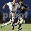Rob Winner – rwinner@shawmedia.com<br /> <br /> DeKalb's Sean Woodford (left) and Belvidere North's Adrian Lopez chase after a ball during the second half at Barb Cup in DeKalb Thursday, Aug. 23, 2012. DeKalb defeated Belvidere North, 3-0.