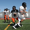 Rob Winner – rwinner@shawmedia.com<br /> <br /> Running back Dre Brown (right) takes a handoff from quarterback Jack Sauter during practice at DeKalb Friday, Aug. 17, 2012.