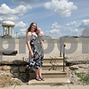 Rob Winner – rwinner@shawmedia.com<br /> <br /> DeKalb resident Julia Dwyer holds her four-month-old daughter, Misty Jade, near the corner of Oak and 10th streets which is the site of a proposed vehicle scrap yard as seen on Saturday, Aug. 18, 2012. Dwyer, who lives on the 1100 block of Oak Street, does not want the scrap yard built across from her home.