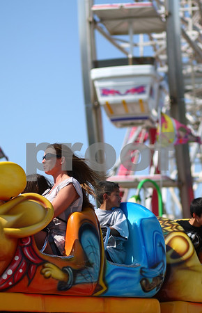 Kyle Bursaw – kbursaw@shawmedia.com<br /> <br /> Kim Larson (front) rides a roller coaster at Cornfest with her niece Meghan Shannon (obscured) on Friday, Aug. 24, 2012.