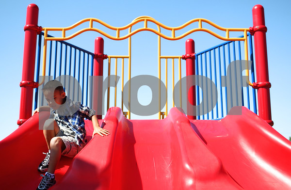 Kyle Bursaw – kbursaw@shawmedia.com<br /> <br /> North Grove Elementary first-grader Adrian Comiskey takes his first trip of the new school year down one of the playground's slides in Sycamore, Ill. on Wednesday, Aug. 22, 2012.