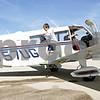 Rob Winner – rwinner@shawmedia.com<br /> <br /> Owen Brown, 8, of Genoa, hops off the wing of Steve Doonan's (right) Piper Cherokee 6 after a Young Eagles flight on Saturday, Aug. 18, 2012, at the DeKalb Taylor Municipal Airport in DeKalb, Ill.